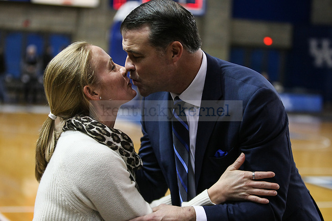 Kentucky head coach Matthew Mitchell kisses his wife, Jenna, after the team's victory over Middle Tennessee State at Memorial Coliseum  on Friday, December 12, 2014 in Lexington, Ky. UK defeated Middle Tennessee 78-62. Photo by Adam Pennavaria | Staff