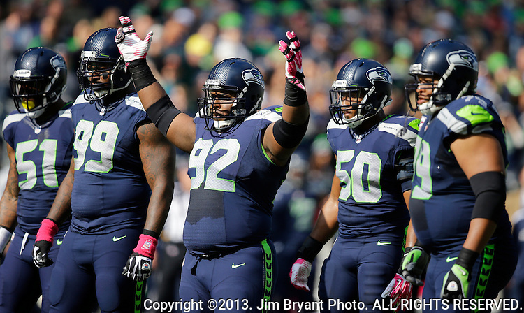 Seattle Seahawks defensive unit defensive Bruce Irvin (51), Tony McDaniel (99), Brandon Mebane (92),  K.J. Wright (50) and Red Bryant (79) wait for the Tennessee Titians offensive unit to line up at CenturyLink Field in Seattle, Washington on October 13, 2013. The Seattle Seahawks beat the Titians  20-13.   ©2013. Jim Bryant Photo. All Rights Reserved.