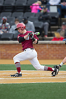 Ben Skinner (1) of the Harvard Crimson follows through on his swing against the Wake Forest Demon Deacons at David F. Couch Ballpark on March 5, 2016 in Winston-Salem, North Carolina.  The Crimson defeated the Demon Deacons 6-3.  (Brian Westerholt/Four Seam Images)