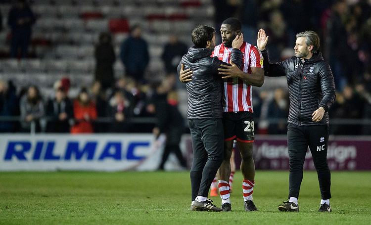 Lincoln City manager Danny Cowley, left, and Lincoln City's assistant manager Nicky Cowley with Lincoln City's John Akinde at the end of the game<br /> <br /> Photographer Chris Vaughan/CameraSport<br /> <br /> The EFL Sky Bet League Two - Lincoln City v Exeter City - Tuesday 26th February 2019 - Sincil Bank - Lincoln<br /> <br /> World Copyright © 2019 CameraSport. All rights reserved. 43 Linden Ave. Countesthorpe. Leicester. England. LE8 5PG - Tel: +44 (0) 116 277 4147 - admin@camerasport.com - www.camerasport.com