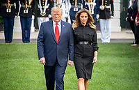 United States President Donald J. Trump and first lady Melania Trump close their eyes as they walk down the South Lawn of the White House to observe a moment of silence at 8:46am EDT in commemoration of  the 18th anniversary of the terrorist attacks on the World Trade Center in New York, NY and the Pentagon in Washington, DC on Wednesday, September 11, 2019.<br /> Credit: Ron Sachs / CNP /MediaPunch