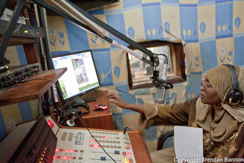 "Pamoja FM radio presenter Miriam Ali Mwinyi on the air with her program ""Women in Islam.""        The Kibera based community radio station broadcasts a full range of news and features all produced in house.     The station began as a music only station. Since 2008 it has grown to include a series of daily news broadcasts. every Friday it features muslim music and every sunday it  hosts a gospel program.                       Nairobi, Kenya. March 11, 2011"
