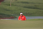 Lee Westwood faces a long putt on the 14th green during the Final Day of the Dubai World Championship Golf in Jumeirah, Earth Course, Golf Estates, Dubai  UAE, 22nd November 2009 (Photo by Eoin Clarke/GOLFFILE)