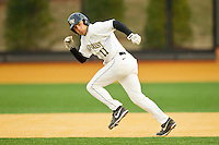 Pat Blair (11) of the Wake Forest Demon Deacons takes off for second base during the game against the Western Carolina Catamounts at Wake Forest Baseball Park on March 26, 2013 in Winston-Salem, North Carolina.  (Brian Westerholt/Four Seam Images)