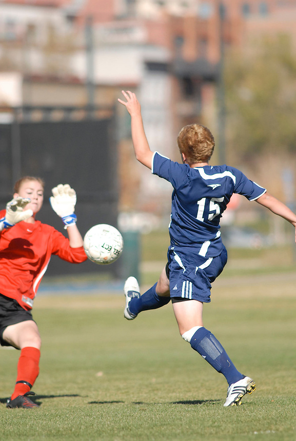 A Fort Lewis womens soccer player scores a goal over a Metro State goalie during the 2007 RMAC playoffs.