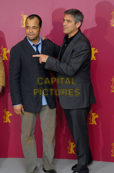 "JEFFREY WRIGHT & GEORGE CLOONEY.Photocall for ""Syriana"" at the 56th Berlin (Berlinale) Film Festival, Berlin, Germany..February 10th, 2006.Ref: KRA.full length grey gray pinstripe suit pointing gesture.www.capitalpictures.com.sales@capitalpictures.com.©Capital Pictures"
