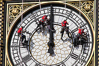 Cleaner,second right,puts his fingers in his ears as Big Ben strikes 11 O'Clock