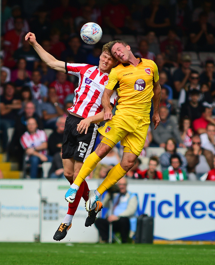 Lincoln City's Rob Dickie vies for possession with Morecambe's Garry Thompson<br /> <br /> Photographer Andrew Vaughan/CameraSport<br /> <br /> The EFL Sky Bet League Two - Lincoln City v Morecambe - Saturday August 12th 2017 - Sincil Bank - Lincoln<br /> <br /> World Copyright &copy; 2017 CameraSport. All rights reserved. 43 Linden Ave. Countesthorpe. Leicester. England. LE8 5PG - Tel: +44 (0) 116 277 4147 - admin@camerasport.com - www.camerasport.com