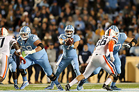 CHAPEL HILL, NC - NOVEMBER 02: Sam Howell #7 of the University of North Carolina takes the snap during a game between University of Virginia and University of North Carolina at Kenan Memorial Stadium on November 02, 2019 in Chapel Hill, North Carolina.
