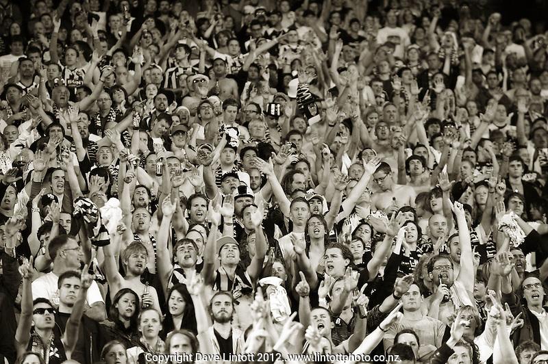 Fans chant during the A-League elimination final football match between Wellington Phoenix v Sydney FC at Westpac Stadium, Wellington, New Zealand on Friday, 30 March 2012. Photo: Dave Lintott / lintottphoto.co.nz