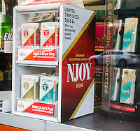 Display of Njoy brand electronic cigarettes in the window of a convenience store in New York on Saturday, September 13, 2014. The alternative to smoking releases water vapor and is advertised as safer being tobacco-free. (© Richard B. Levine)