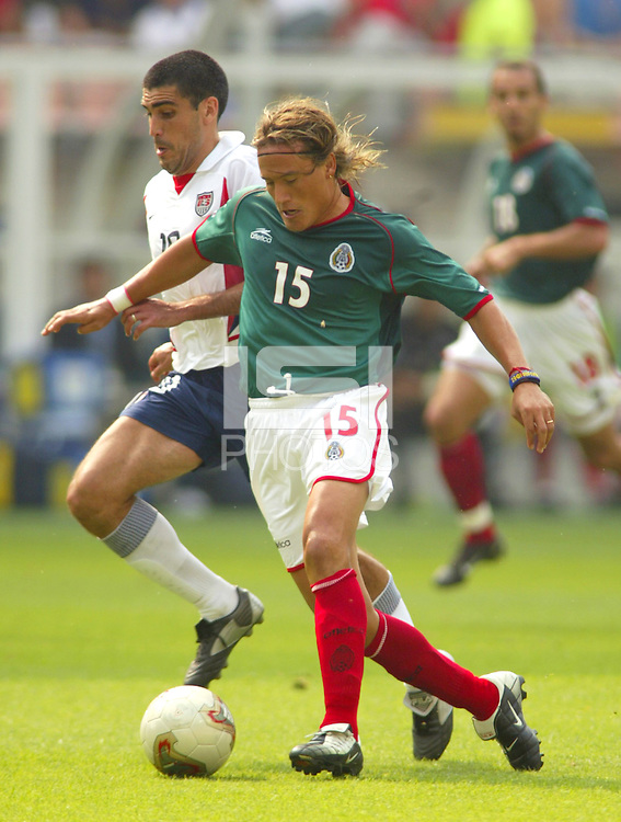 Mexico's Luis Hernandez keeps Claudio Reyna from the ball. The USA defeated Mexico 2-0 in the Round of 16 of the FIFA World Cup 2002 in South Korea on June 17, 2002.