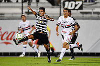 Orlando, FL - Saturday Jan. 21, 2017: Corinthians midfielder Guilherme (10) reaches out to settle the ball away from São Paulo midfielder J. Schimidt (15) during the first half of the Florida Cup Championship match between São Paulo and Corinthians at Bright House Networks Stadium.