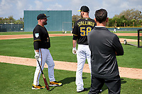 Pittsburgh Pirates Garth Brooks (7) talks with Jacob Stallings (58) during the teams first Spring Training practice on February 18, 2019 at Pirate City in Bradenton, Florida.  (Mike Janes/Four Seam Images)