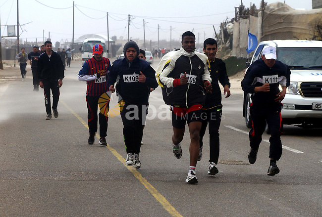 Participants compete in the UN-sponsored Gaza marathon in Gaza City on March 1, 2012. Thousands of runners braved temperatures hovering just above zero degrees centigrade to take part in the impoverished Palestinian territory's second-ever marathon. Photo by Ashraf Amra