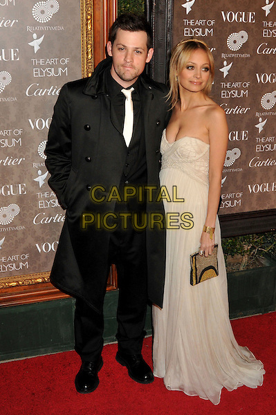 JOEL MADDEN & NICOLE RICHIE .2nd Annual Art of Elysium Heaven Gala at Vibiana, Los Angeles, CA, USA, .10 January 2009..full length black coat tie suit strapless white cream long maxi gold clutch bag dress.CAP/ADM/BP.©Byron Purvis/Admedia/Capital PIctures