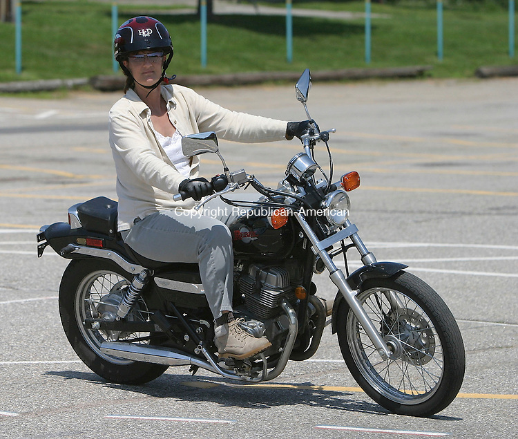 WATERBURY, CT 24 July 2005 -072405BZ04-  Diane Cseh (CQ), 48, of Morris, rides a motorcycle during the Basic Rider Course at Naugatuck Valley Community College Sunday.<br /> Jamison C. Bazinet Photo