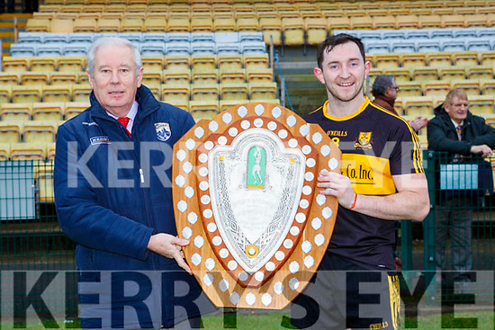 Christy Killeen presents the County League Div 1 shield to Daithi Casey  Dr Crokes in Lewis Rd on Sunday
