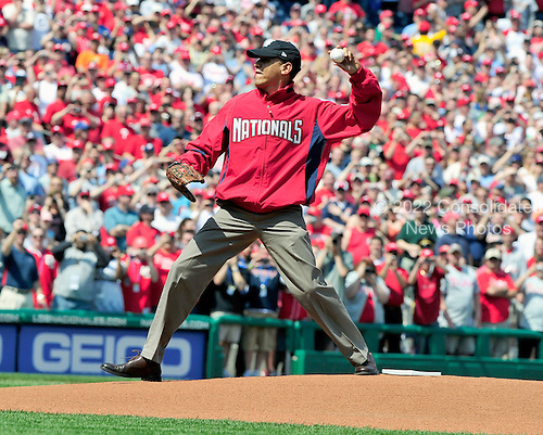 Washington, DC - April 5, 2010 -- United States President Barack Obama throws out the first ball to open the 2010 Major League season in Washington, D.C. as the Philadelphia Phillies visit the Washington Nationals at Nationals Park on Monday, April 5, 2010..Credit: Ron Sachs / CNP