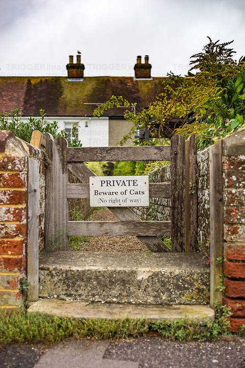 Sign on gate 'beware of cats' in Bosham in West Sussex