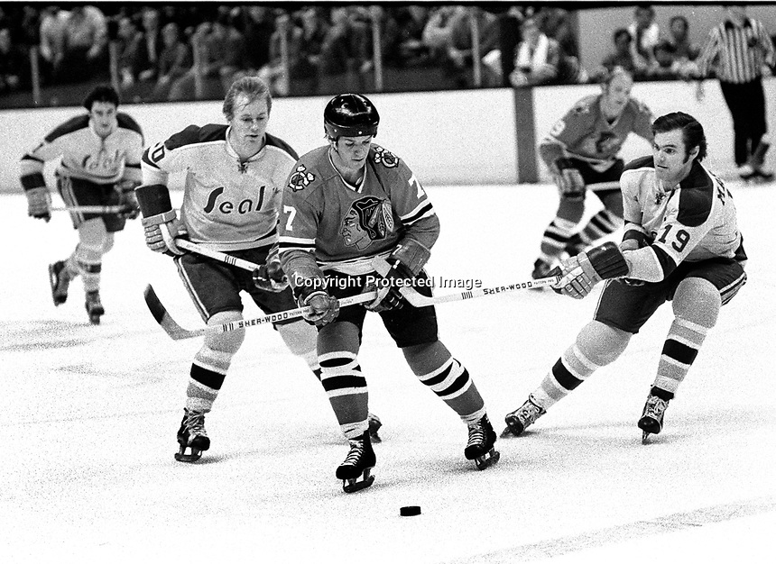 Seals vs BlackHawks 1971: Seals Stan Gilbertson and Bert Marshall battle Hawks Pit Martin..(photo/Ron Riesterer)