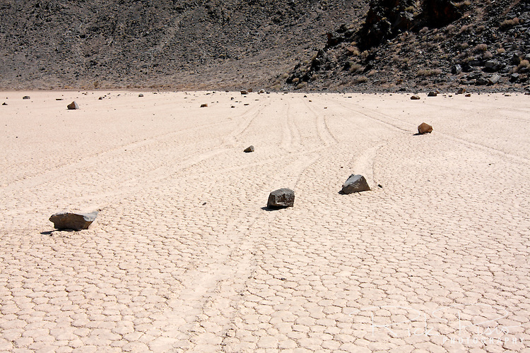 The trail left by a moving rock on the Racetrack Playa in Death Valley National Park is evidence of the rocks motion across the playa. Racetrack Playa is a seasonally dry lake (a playa) located in the northern part of the Panamint Mountains nestled between the Cottonwood Mountains to the east and the Last Chance Range to the west in Southeastern California. The Racetrack Playa is known for its 'sailing stones' which are rocks that mysteriously move across its surface.