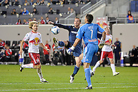 Chad Barrett (11) of the Los Angeles Galaxy attempts to score past New York Red Bulls goalkeeper Frank Rost (1). The New York Red Bulls defeated the Los Angeles Galaxy 2-0 during a Major League Soccer (MLS) match at Red Bull Arena in Harrison, NJ, on October 4, 2011.
