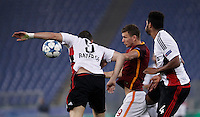 Calcio, Champions League, Gruppo E: Roma vs Bayer Leverkusen. Roma, stadio Olimpico, 4 novembre 2015.<br /> Bayer Leverkusen's Kyriakos Papadopoulos, left, and Jonathan Tah and Roma's Edin Dzeko fight for the ball during a Champions League, Group E football match between Roma and Bayer Leverkusen, at Rome's Olympic stadium, 4 November 2015.<br /> UPDATE IMAGES PRESS/Isabella Bonotto