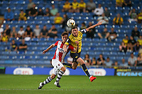 John Lundstram of Oxford United beats Max Smallcombe of Exeter City in the air during the The Checkatrade Trophy match between Oxford United and Exeter City at the Kassam Stadium, Oxford, England on 30 August 2016. Photo by Andy Rowland / PRiME Media Images.