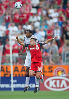 13 August 2011: Real Salt Lake defender Chris Schuler #28 and Toronto FC forward Peri Marosevic #70 in action during a game between Real Salt Lake and Toronto FC at BMO Field in Toronto.