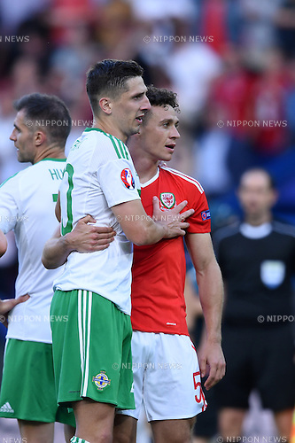 Kyle Lafferty (Northern Ireland)James Chester (Wales) ; <br /> June 25, 2016- Football : Uefa Euro France 2016, Round of 16, Wales 1-0 Northern Ireland at Stade Parc des Princes, Paris, France. (Photo by aicfoto/AFLO)
