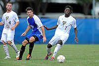 2 October 2011:  FIU defender Jahbari Willis (7) pursues a loose ball in the second half as the FIU Golden Panthers defeated the University of Kentucky Wildcats, 1-0 in overtime, at University Park Stadium in Miami, Florida.