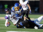 BROOKINGS, SD - DECEMBER 2: Xavior Williams #9 from Northern Iowa is brought down by a pair of defenders from South Dakota State University during their FCS Division 1 playoff game Saturday afternoon at Dana J. Dykhouse Stadium in Brookings, SD. (Photo by Dave Eggen/Inertia)