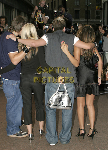"""New York Minute"" premiere at Odeon West End cinema, Leicester Square.London 27 July 2004.music, group, band, full length, back, behind, rear, silver, metallic bag, purse.www.capitalpictures.com.sales@capitalpictures.com.© Capital Pictures."