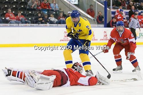 Filip Novotny (Czech Republic - 1), Jonathan Johansson (Sweden - 21), Jakub Jerabek  (Czech Republic - 15) - Sweden defeated the Czech Republic 4-2 at the Urban Plains Center in Fargo, North Dakota, on Saturday, April 18, 2009, in their final match of the 2009 World Under 18 Championship.