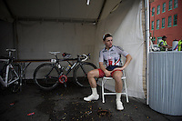 A British youngster that had to abandon the race waits in the team pits while his competitors are still out<br /> <br /> Men Junior Road Race<br /> UCI Road World Championships Richmond 2015 / USA
