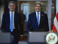 Washington, DC - October 8, 2014: U.S. Secretary of State John Kerry (r) and U.K. Foreign Secretary Philip Hammond enter the Treaty Room at the Department of State, October 8, 2014, for a joint press availability.   (Photo by Don Baxter/Media Images International)