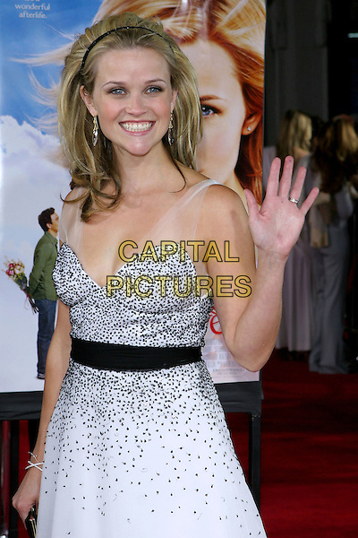 "REESE WITHERSPOON.At the Los Angeles Premiere of ""Just Like Heaven"" held at Graumann's Chinese Theatre,.Los Angeles, 8th Septeber 2005.half length black white layer chiffon dress crystal earrings alice hair band belt wave waving.Ref: ADM/JW.www.capitalpictures.com.sales@capitalpictures.com.© Capital Pictures."