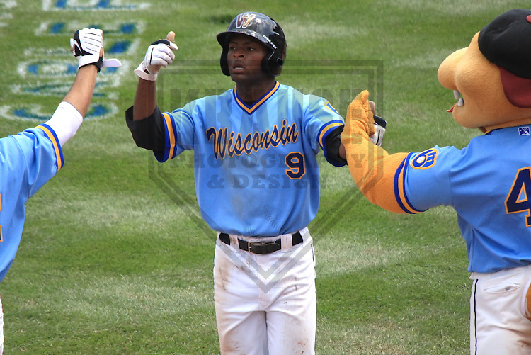APPLETON - MAY 2010: D'Vontrey Richardson #9 of the Wisconsin Timber Rattlers, Class-A affiliate of the Milwaukee Brewers, during a game on May 23, 2010 at Fox Cities Stadium in Appleton, Wisconsin. (Photo by Brad Krause)