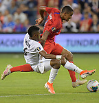 Kevin Galvan (6) of Panama and Reggie Cannon (14) of the United States vie for the ball during their Gold Cup match on June 26, 2019 at Children's Mercy Park in Kansas City, KS.<br /> Tim VIZER/AFP