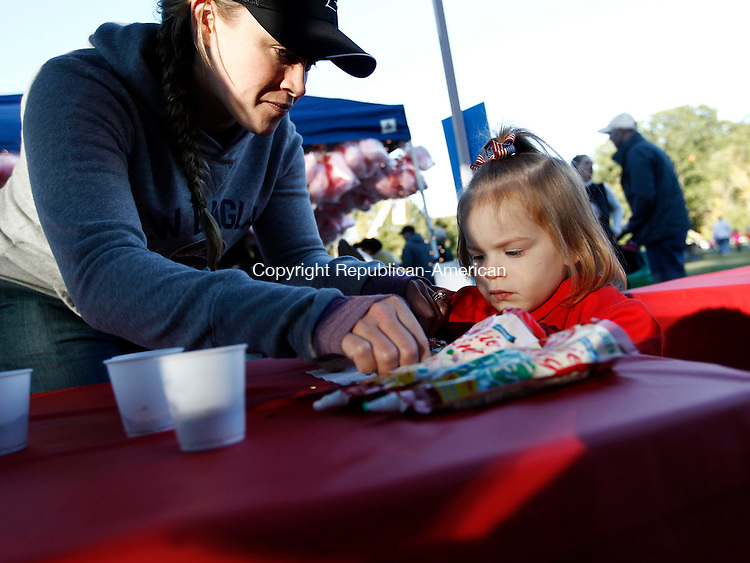 Southbury, CT- 05 October 2014-100514CM11-  Lily Andruck of Oxford makes a cookie with her daughter Raylee, 2, during the 16th annual Southbury Celebration on at the Southbury Training School on Sunday.  The gathering was to bring the community together to celebrate fall.  It featured food music and fireworks.    Christopher Massa Republican-American