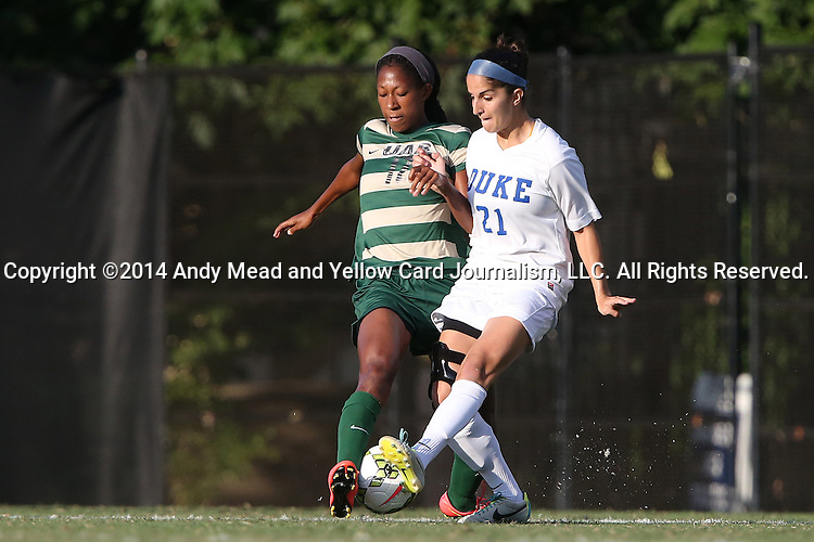 31 August 2014: UAB's Kimberly Fincher (12) blocks a pass by Duke's Gilda Doria (21). The Duke University Blue Devils hosted the University of Alabama Birmingham Blazers at Koskinen Stadium in Durham, North Carolina in a 2014 NCAA Division I Women's Soccer match. Duke won the game 3-1.