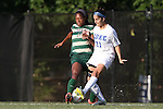 31 August 2014: UAB's Kimberly Fincher (12) blocks a pass by Duke's Gilda Doria (21). The Duke University Blue Devils hosted the University of Alabama Birmingham Blazers at Koskinen Stadium in Durham, North Carolina in a 2014 NCAA Division I Women's Soccer match. Duke won the game 3-1.