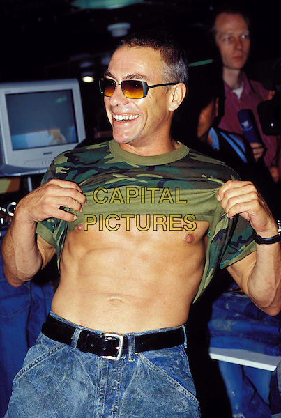 JEAN CLAUDE VAN DAMME.Ref:10958.stomach, six pack, muscles from brussels, sunglasses, shades, hal length, half-length.www.capitalpictures.com.sales@capitalpictures.com.© Capital Pictures.