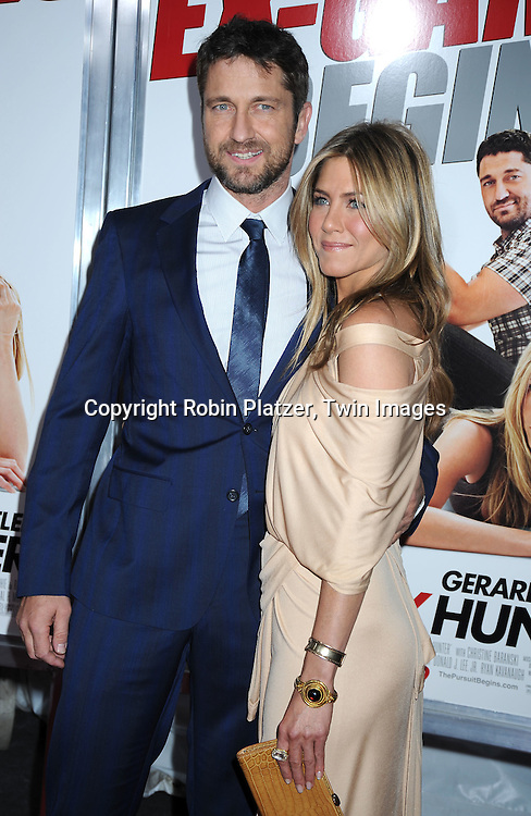 "Gerard Butler and Jennifer Aniston attending the New York Premiere of ""The Bounty Hunter"" on March 16, 2010 at The Ziegfeld Theatre. Gerard Butler and Jennifer Aniston are the stars of the movie"