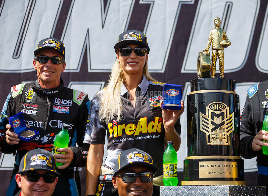 Sep 18, 2016; Concord, NC, USA; NHRA top fuel driver Leah Pritchett (right) and Clay Millican alongside the championship trophy during the Carolina Nationals at zMax Dragway. Mandatory Credit: Mark J. Rebilas-USA TODAY Sports