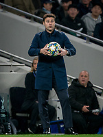 Spurs manager Mauricio Pochettino holds the matchball during the UEFA Champions League group match between Tottenham Hotspur and Bayern Munich at Wembley Stadium, London, England on 1 October 2019. Photo by Andy Rowland.
