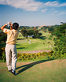 SINGAPORE, Asia, rear view of man playing golf at Sentosa Resort