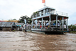 A ferry crowded with passengers prepares to cross the Hau River in the Mekong Delta, south of Can Tho, Vietnam. Sept. 30, 2011.