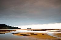 Sunset on a beach at Marahau - Abel Tasman National Park, Nelson Region, New Zealand